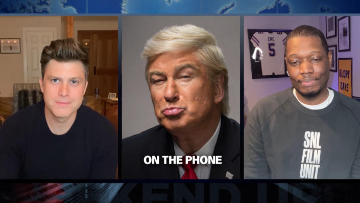 """SATURDAY NIGHT LIVE -- """"Tom Hanks"""" Episode 1783Q -- Pictured in this screengrab: (l-r) Anchor Colin Jost, Alec Baldwin as Donald Trump, and Michael Che during Weekend Update on Saturday, April 11, 2020 -- (Photo by: NBC/NBCU Photo Bank via Getty Images)"""