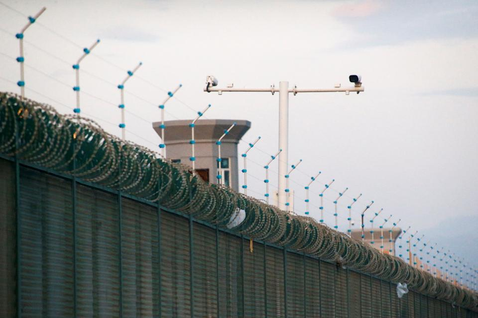 Security cameras are installed above the perimeter fence of what is officially known as a vocational skills education centre in Dabancheng, in Xinjiang Uighur Autonomous Region, China.