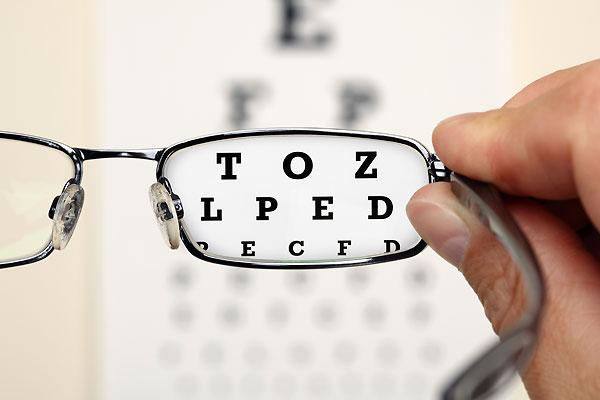 """<b>Macular Degeneration</b><br><br>Macular degeneration (AMD) is a condition in which the macula, where most of your coloured, detailed and functional vision comes from, begins to have spots of buildup called <a target=""""_blank"""" href=""""http://www.amdsupport.ca/2008/04/15/dry-macular-degeneration-what-is-drusen/"""">drusen </a>– areas that are not getting enough blood supply.<br><br>Causes of AMD include UV exposure from the sun, and blue light from electronic devices.<br><br>""""That is the next frontier of protection,"""" says Angle. """"There are lens coatings now for clear lenses that we're working to filter out those blue lights coming from devices."""" He adds that filtering blue light can help to clear your vision as well because blue light is actually quite blurry on the spectrum.<br><br>Symptoms of AMD include blurry vision, and areas of vision that are distorted or missing – generally in the central field of vision.<br><br>""""Sometimes people will report that if they're reading that parts of the sentence, the words might be missing and they have to look beside it to see what they're reading,"""" explains Angle.<br><br>Basically, it's the opposite of tunnel vision, and because there are no pain receptors in the area of the eye that AMD affects, you won't feel anything as a result of this disease.<br><br>""""It's quite debilitating if it progresses because you lose your ability to read, to see colours, to see any detail,"""" he says. """"So when you're looking at a loved one you're not going to see their facial features, you're just going to see around them.""""<br><br>Early detection is key to treating AMD, as it can be 'held steady' in its early (dry) stages with dietary and vitamin therapy.<br><br>""""Diet is huge when it comes to preventing macular degeneration,"""" says Angle. Foods like dark leafy green vegetables, orange and yellow bell peppers <a target=""""_blank"""" href=""""http://eyefoods.com/"""">among others</a> all have healthy plant pigments that can help protect the macula. Another big factor,"""