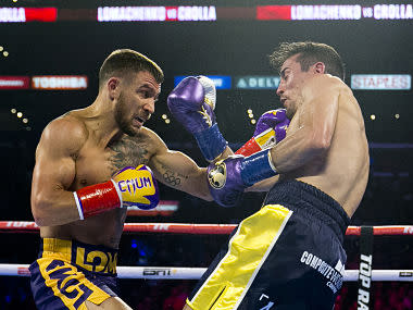 Vasiliy Lomachenko destroys Anthony Crolla with fourth round knock out to retain WBA and WBO titles