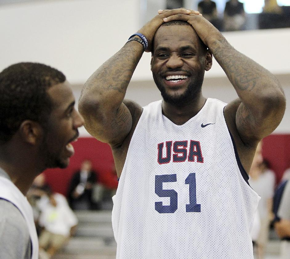 USA men's national basketball team member LeBron James (51) laughs with teammate Chris Paul during practice at the Mendenhall Center on the UNLV campus in Las Vegas on Friday, July 6, 2012. (AP Photo/Las Vegas Review-Journal, Jason Bean)