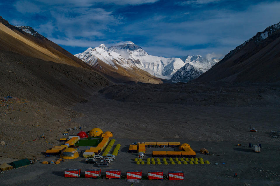 """In this aerial photo released by Xinhua News Agency, the Mount Qomolangma, also known as Mount Everest, base camp is seen on May 25, 2020. China will draw a """"separation line"""" atop Mount Everest to prevent the coronavirus from being spread by climbers ascending from Nepal's side of the mountain, Chinese state media reported Monday, May 10, 2010. (Purbu Zhaxi/Xinhua via AP)"""