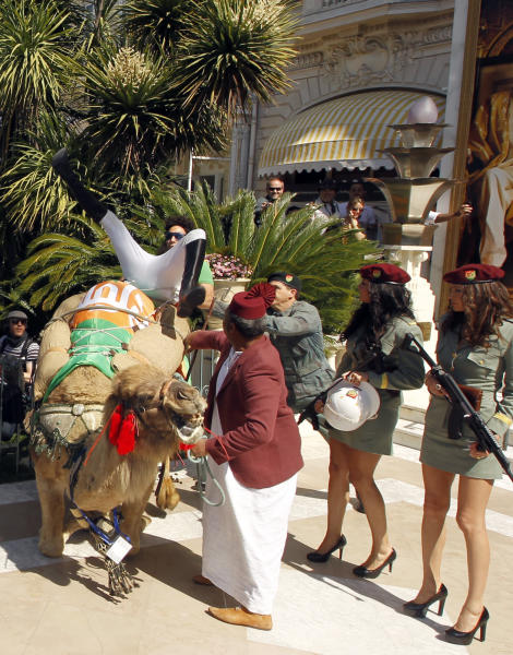 Actor Sacha Baron Cohen, left, falls off a camel during a photo call for The Dictator at the 65th international film festival, in Cannes, southern France, Wednesday, May 16, 2012. (AP Photo/Joel Ryan)