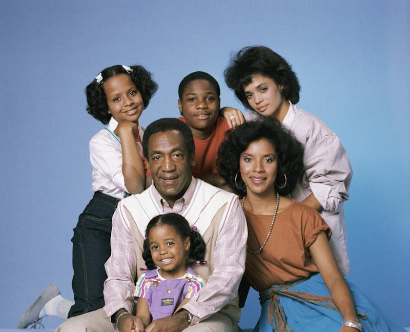 "The cast of ""The Cosby Show"" for season 1: (clockwise from top left) Tempestt Bledsoe as Vanessa Huxtable, Malcolm-Jamal Warner as Theodore ""Theo"" Huxtable, Lisa Bonet as Denise Huxtable, Phylicia Rashad as Clair Hanks Huxtable, Keshia Knight Pulliam as Rudy Huxtable, (center) Bill Cosby as Dr. Heathcliff ""Cliff"" Huxtable. (NBC via Getty Images)"