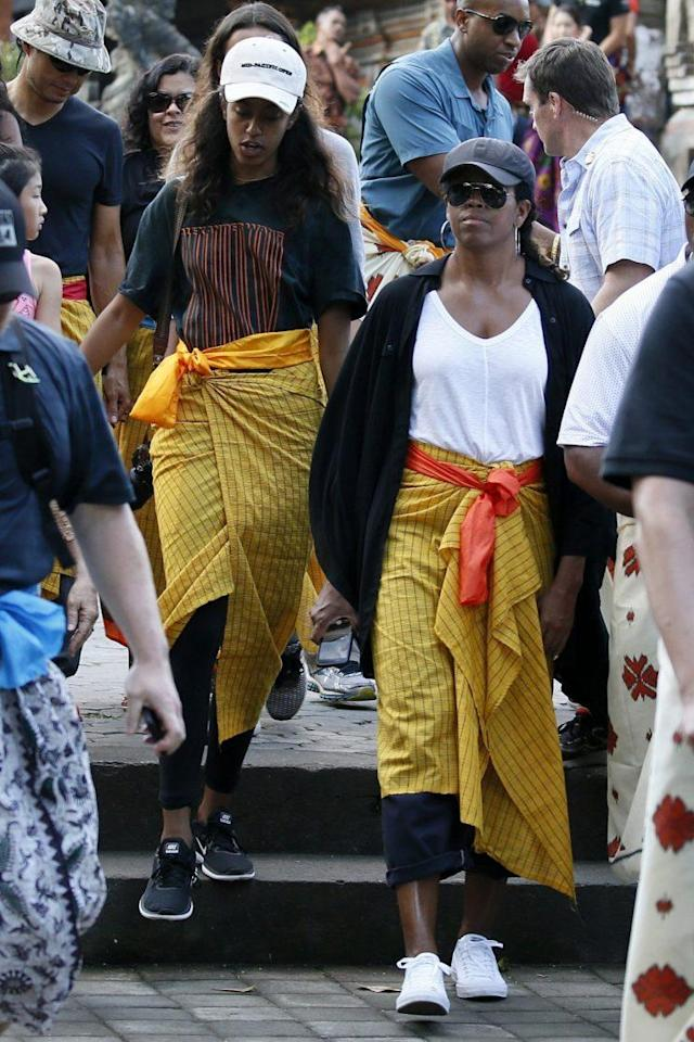 Michelle Obama wearing a traditional wrap on vacation in Indonesia. (Photo: AP)