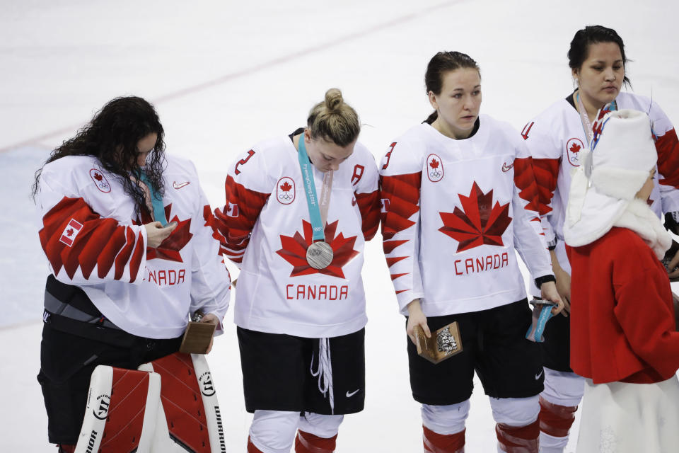 Jocelyne Larocque (second from right) immediately took off her silver medal after losing to Team USA. (AP)