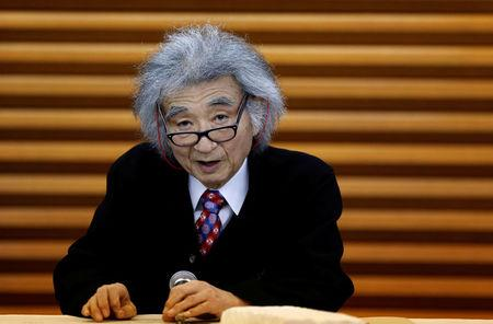 FILE PHOTO: Japan's maestro Ozawa speaks during a news conference in Tokyo