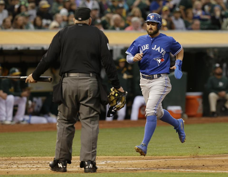 Toronto Blue Jays' Kevin Pillar scores against the Oakland Athletics in the third inning of a baseball game Tuesday, July 21, 2015, in Oakland, Calif. Pillar scored on a single by Toronto's Jose Reyes. (AP Photo/Ben Margot)