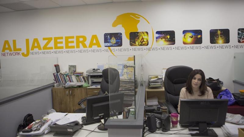 Israel plans to revoke the media credentials of Al Jazeera TV journalists working in the country.