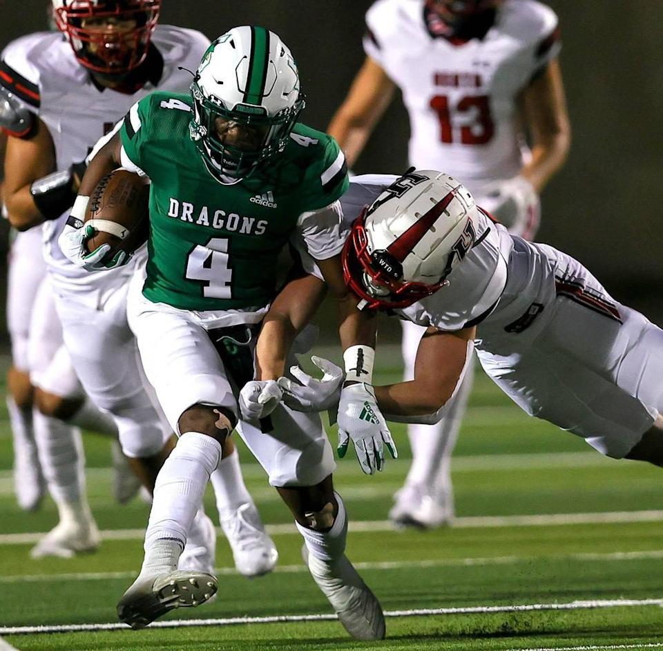 Southlake Carroll kickoff returner Cinque Williams tries to break a tackle against Rockwall Heath during the first half of a High School Football game, Friday night, October 2, 2020 played at Dragon Stadium in Southlake, TX. (Steve Nurenberg Special to the Star-Telgram)