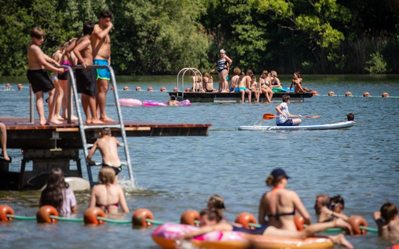 02 June 2020, Baden-Wuerttemberg, Plüderhausen: People enjoy the sunny day at the bathing lake in Plüderhausen. Photo: Christoph Schmidt/dpa (Photo by Christoph Schmidt/picture alliance via Getty Images)