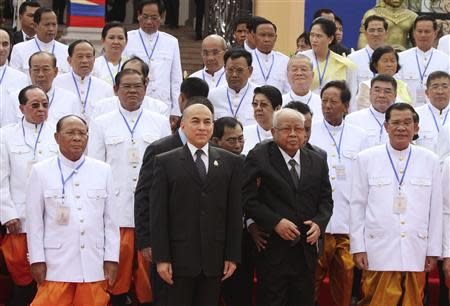 Cambodia's King Norodom Sihamoni and members of the Cambodian People's Party pose for a photograph during a new parliament session in central Phnom Penh