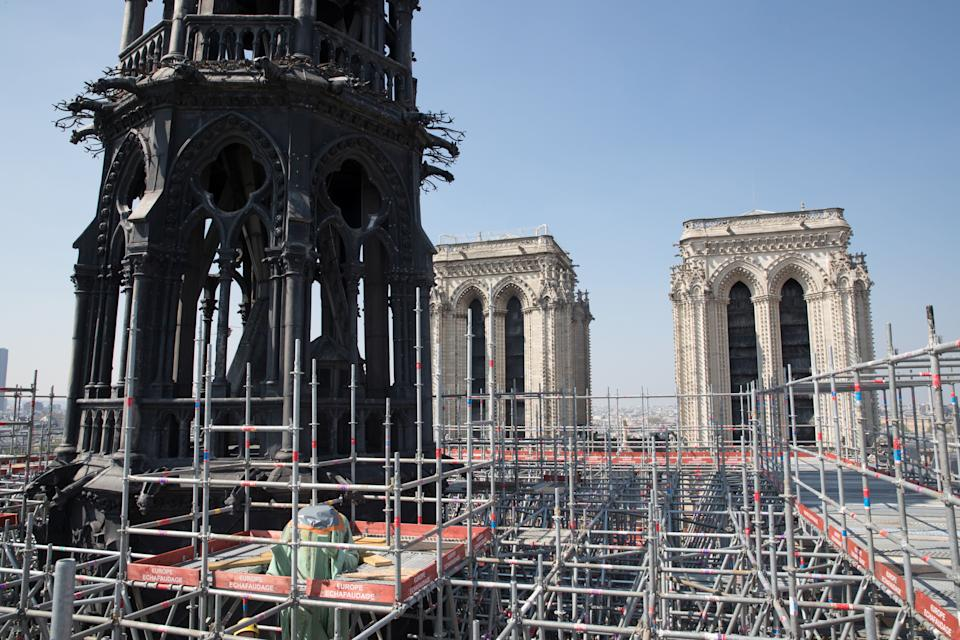 A view shows scaffolding around the spire of Notre-Dame cathedral during restoration work in Paris, France, April 11, 2019. Picture taken April 11, 2019.  REUTERS/Philippe Wojazer