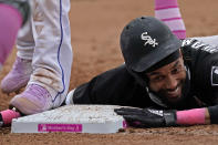 Chicago White Sox's Billy Hamilton dives safely back to first on a pickoff attempt during the eighth inning of a baseball game against the Kansas City Royals Sunday, May 9, 2021, in Kansas City, Mo. (AP Photo/Charlie Riedel)