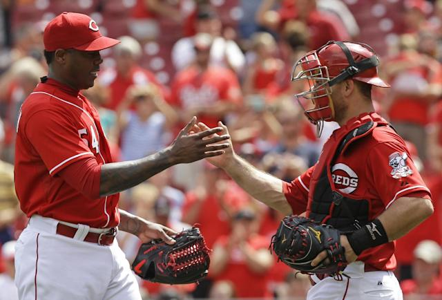 Cincinnati Reds relief pitcher Aroldis Chapman, left, is congratulated by catcher Devin Mesoraco after they defeated the Chicago Cubs 4-2 in a baseball game, Tuesday, July 8, 2014, in Cincinnati. Chapman earned his 18th save. (AP Photo/Al Behrman)