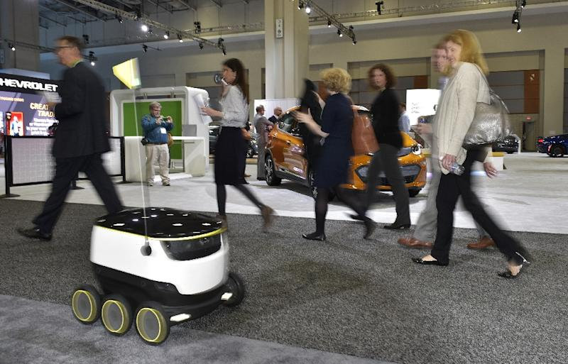 """New six-wheeled robots from Starship Technologies are part of a new wave of automated systems taking aim at the """"last mile"""" delivery of goods to consumers (AFP Photo/Mandel Ngan)"""