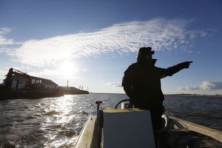 Saxis Island resident and duck decoy carver Grayson Chesser takes to the water off this historic fishing village on Virginia's Eastern Shore, October 25, 2013. REUTERS/Kevin Lamarque