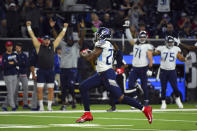 Tennessee Titans running back Derrick Henry (22) rushes for a 53-yard touchdown against the Houston Texans during the second half of an NFL football game Sunday, Dec. 29, 2019, in Houston. Henry's run put him into first place for the season rushing title. (AP Photo/Eric Christian Smith)