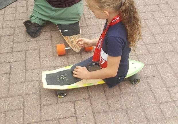 Milania Keeler's green skateboard, which she completed a 5K on back in 2019 in Edmonton, has been stolen and now her family is trying to get it back.