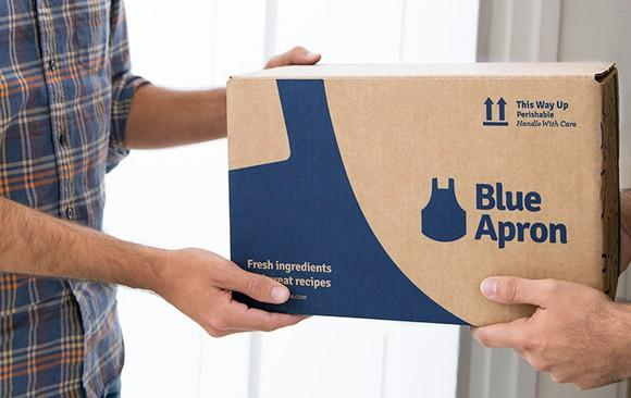 Blue Apron meal kit being handed off