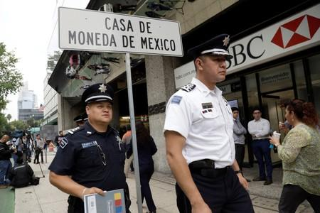 Police officers are seen during a security operation after armed robbers stole gold coins worth more than $2 million, outside Casa de Moneda in Mexico City