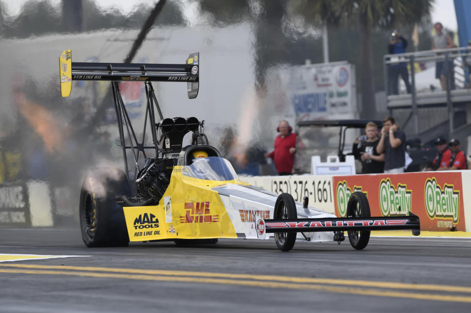 In this photo provided by the NHRA, Richie Crampton drives in Top Fuel at the NHRA Gatornationals drag races Sunday, March 18, 2018, in Gainesville, Fla. Crampton got the uncontested win when he piloted his dragster to the winning run of 3.854 seconds at 314.90 mph after Shawn Reed had to shut off his dragster on the starting line. (Jerry Foss/NHRA via AP)