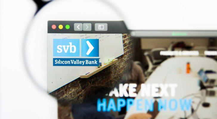 a magnifying glass enlarges the Silicon Valley Bank logo on a website