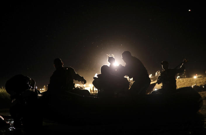 United States agents rescue a migrant child from the waters of the Rio Grande after her parents lost their footing and their children began to be swept away by the current on the American side of the border between Ciudad Acuna, Mexico, and Del Rio, Texas Thursday, Sept. 23, 2021. . (AP Photo/Felix Marquez)