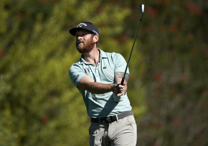 Tyler McCumber watches his tee shot on the fourth hole during the second round of the Genesis Invitational golf tournament at Riviera Country Club, Friday, Feb. 19, 2021, in the Pacific Palisades area of Los Angeles. (AP Photo/Ryan Kang)