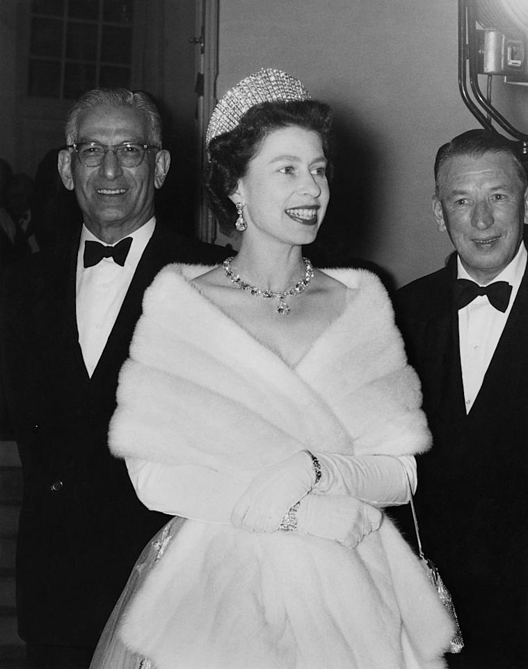 <p>Wearing a glittering tiara, Queen Elizabeth arrived to a luncheon given by the Governor of Peshawar.</p>