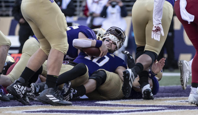 Washington quarterback Jacob Eason scores a touchdown during the first half an NCAA college football game against Washington State, on Friday, Nov. 29, 2019 in Seattle. (AP Photo/Stephen Brashear)