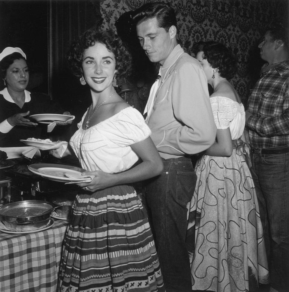 """<p>Elizabeth rebounded from her broken engagement with hotel heir Conrad Hilton Jr. The young couple were married in Beverly Hills on May 6, 1950. Their wedding was two days before the release of her new film, <em>Father of the Bride, </em>and served as major publicity for the movie. As a result, <a href=""""https://www.refinery29.com/en-gb/elizabeth-taylor-wedding-conrad-hilton"""" rel=""""nofollow noopener"""" target=""""_blank"""" data-ylk=""""slk:MGM paid for all the costs"""" class=""""link rapid-noclick-resp"""">MGM paid for all the costs</a>.</p>"""
