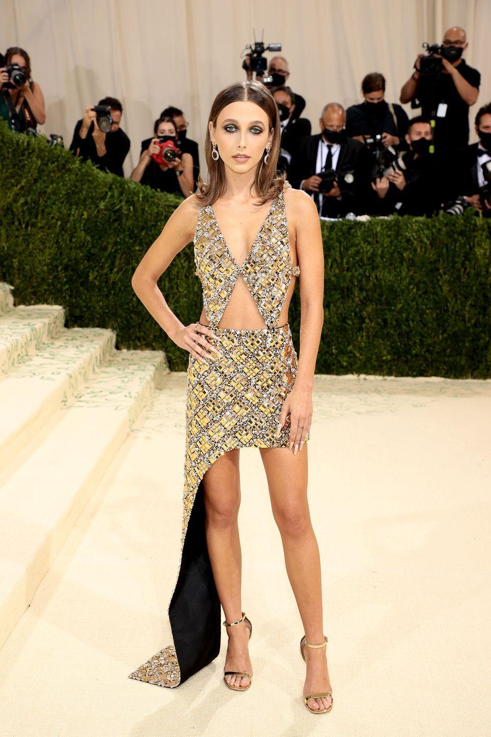 <p>Internet star Emma Chamberlain wore a glamorous Louis Vuitton cutout high-low gown embellished with yellow jewels, and paired the piece with circular white jewel earrings. She wore her hair in a sleek straight hairstyle to keep all eyes on the stunning gown.</p>