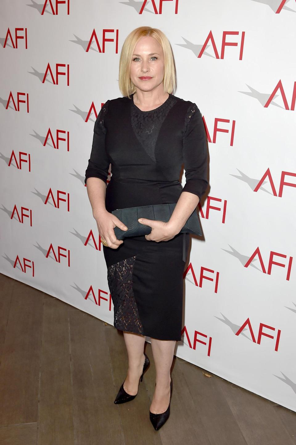 "Patricia Arquette, who worked on ""Boyhood"" over a 12-year period, went for basic black dress with lace detail on the hem of the skirt."