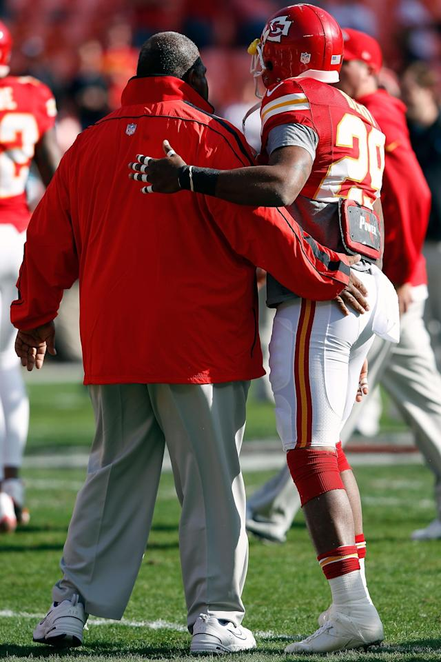 KANSAS CITY, MO - DECEMBER 02: Head coach Romeo Crennel of the Kansas City Chiefs receives a hug from strong safety Eric Berry #29 during player warm-ups prior to the game against the Carolina Panthers at Arrowhead Stadium on December 2, 2012 in Kansas City, Missouri. (Photo by Jamie Squire/Getty Images)