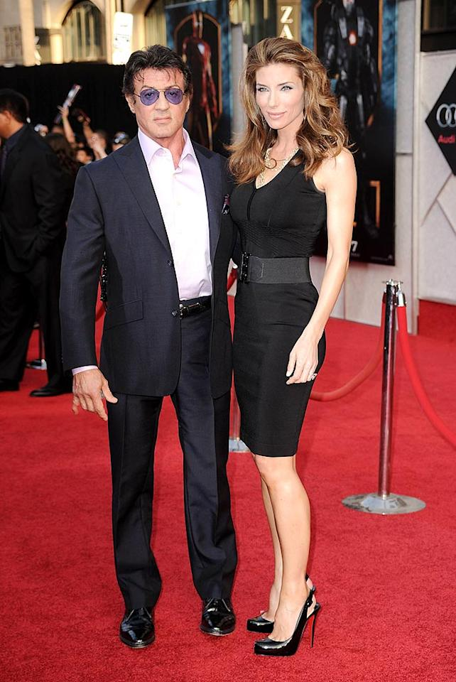 "Aging action hero Sylvester Stallone hit the arrivals line with his gorgeous model wife Jennifer Flavin. Steve Granitz/<a href=""http://www.wireimage.com"" target=""new"">WireImage.com</a> - April 26, 2010"