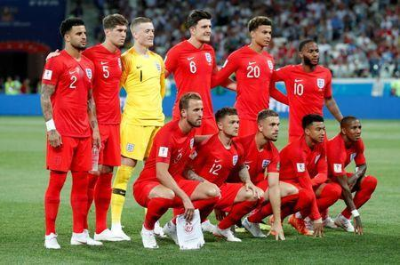 England players pose for a team group photo before the match. REUTERS/Toru Hanai