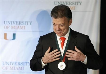 Colombia's President Juan Manuel Santos reacts after he received the 'President's Medal' from University of Miami President Donna Shalala during his visit to the University in Coral Gables