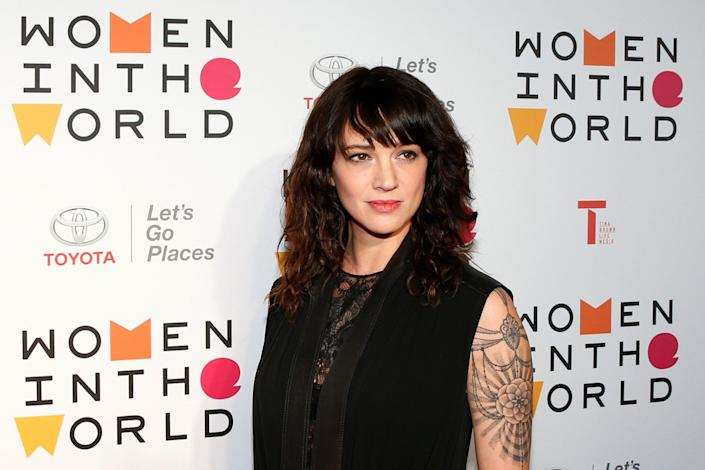 Asia Argento has denied having had a sexual relationship with Jimmy Bennett. An intimate photo of the couple and alleged text messages sent from her appears to contradict that claim. (Photo: Brendan McDermid / Reuters)
