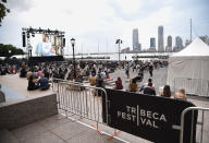 """Filmgoers watch the premiere of """"Roadrunner: A Film About Anthony Bourdain"""" during the 20th Tribeca Festival at Brookfield Place on Friday, June 11, 2021, in New York. (Photo by Evan Agostini/Invision/AP)"""