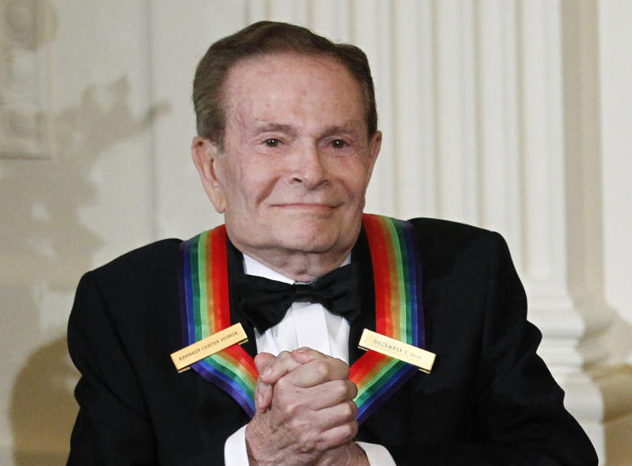 "FILE - In this Dec. 5, 2010, file photo, composer Jerry Herman, one of the recipients of the 2010 Kennedy Center Honors is introduced during a reception in the East Room of the White House in Washington. Herman, the Tony Award-winning composer behind ""Hello, Dolly!"" and ""La Cage aux Folles,"" has died at age 88. (AP Photo/Manuel Balce Ceneta, File)"
