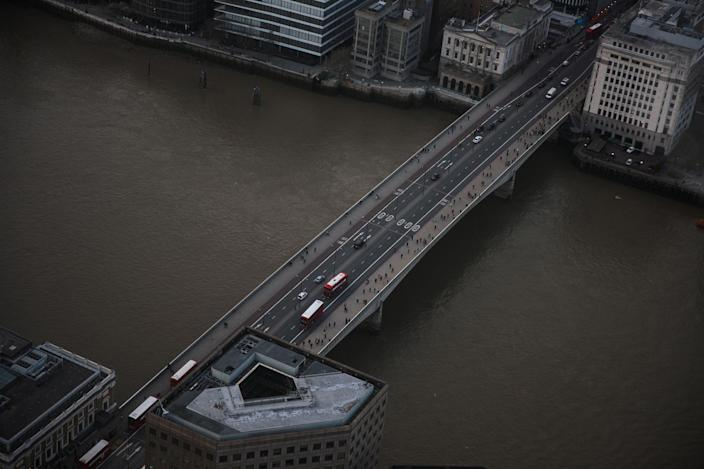 <p>London Bridge extends across the Thames from the Shard, the tallest building in the European Union, as the sun sets on March 28, 2017 in London, England. (Jack Taylor/Getty Images) </p>