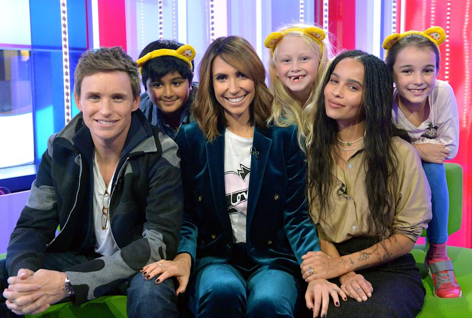 Eddie Redmayne and Zoe Kravitz played a joke on The One Show presenter Alex Jones with the help of (left to right) Vidhit Nihal, 8, Kelsey Wheatley, 7, and Lucy Subbiah, 9 during The One Show for BBC Children in Need.