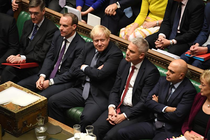 "Britain's Prime Minister Boris Johnson looks on, with arms crossed, next to Brexit Secretary Stephen Barclay ahead of a vote on the prime minister's renegotiated Brexit deal, on what has been dubbed ""Super Saturday"", in the House of Commons in London, Britain October 19, 2019. ©UK Parliament/Jessica Taylor/Handout via REUTERS ATTENTION EDITORS - THIS IMAGE WAS PROVIDED BY A THIRD PARTY"