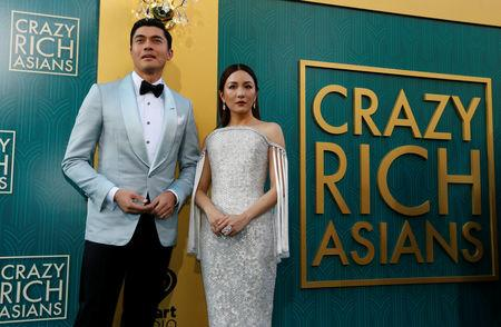 "Cast members Golding and Wu pose at the premiere for ""Crazy Rich Asians"" in Los Angeles"