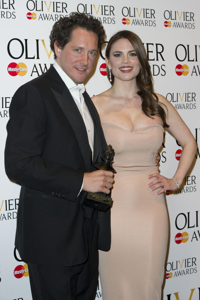 British actor, Bertie Carvel, and British actress, Hayley Atwell, poses with his award for Best Actor in a Musical at the Olivier Awards at the Royal Opera House, London, Sunday, April 15, 2012. (AP Photo/Jonathan Short)