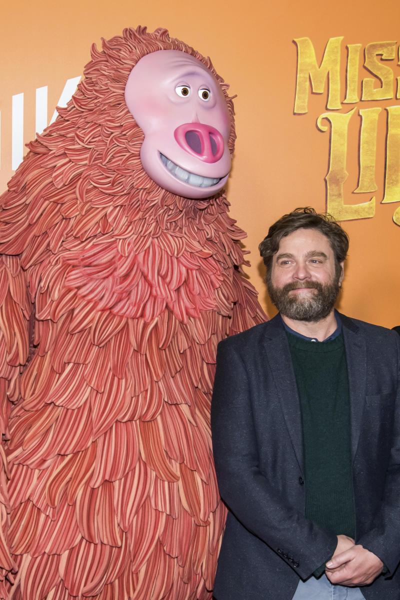 "Zach Galifianakis poses with a costumed character from the film at the premiere of ""Missing Link"" at Regal Cinemas Battery Park on Sunday, April 7, 2019, in New York. (Photo by Charles Sykes/Invision/AP)"