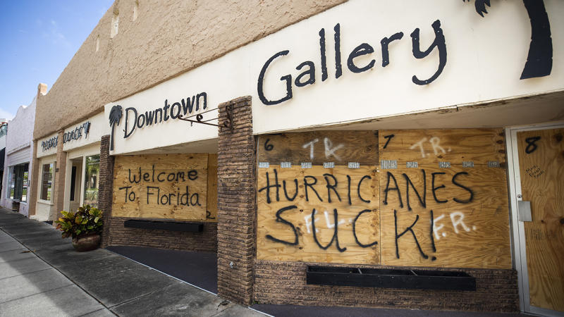 Plywood protectors over windows carry a message for Hurricane Dorian in Titusville, Florida. The hurricane has already made landfall in the Bahamas.