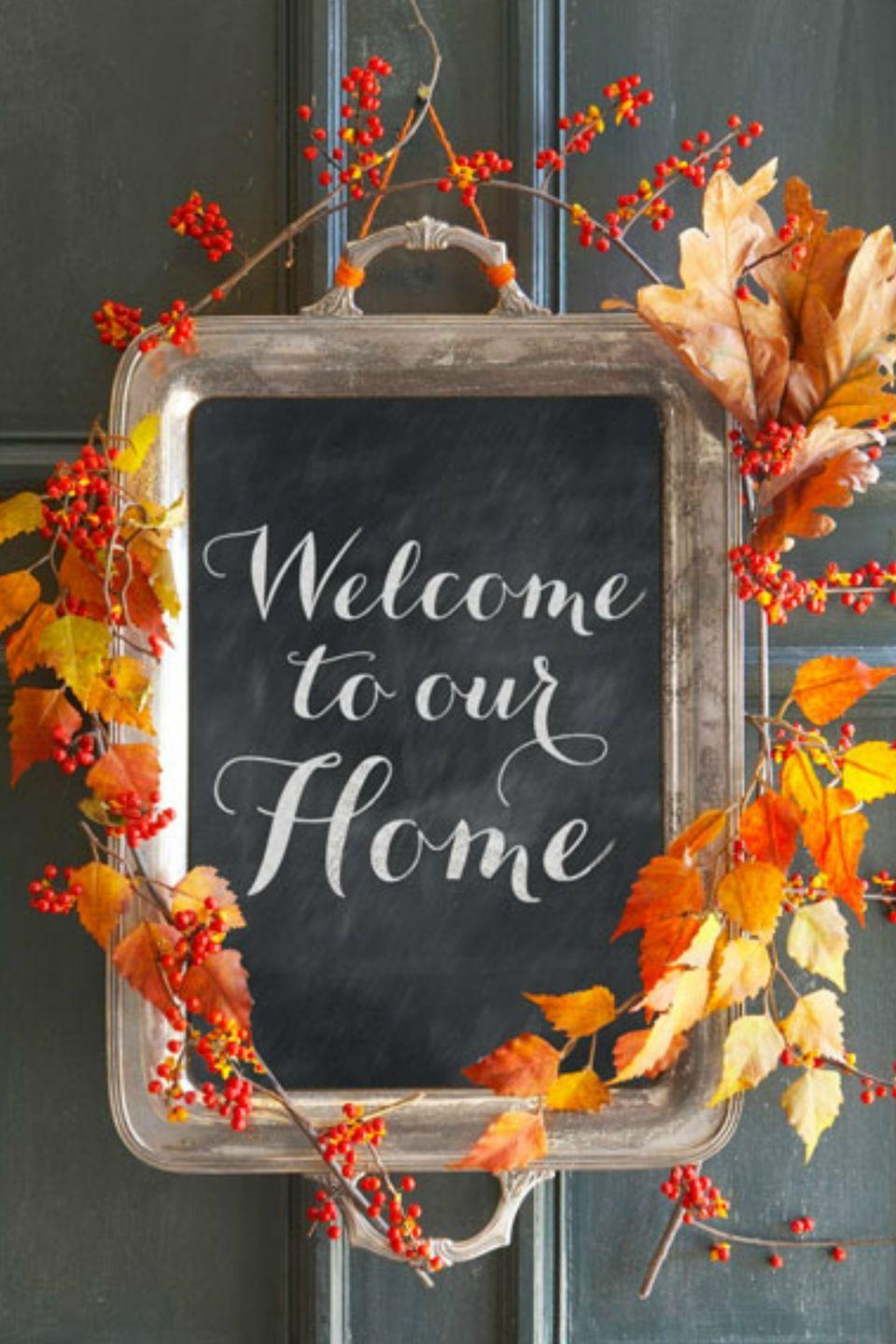 "<p>Greet guests with this charming alternative to a fall wreath. Simply apply a layer of chalkboard paint to the inside of an old tray, then add autumn branches and bittersweet berries for a seasonal finish. (Swap in evergreen and holly for the holidays!)</p><p><strong><a class=""link rapid-noclick-resp"" href=""https://www.amazon.com/DecoArt-Americana-Chalkboard-Paint-2-Ounce/dp/B003ULNC0Q/?th=1&tag=syn-yahoo-20&ascsubtag=%5Bartid%7C10050.g.2063%5Bsrc%7Cyahoo-us"" rel=""nofollow noopener"" target=""_blank"" data-ylk=""slk:SHOP CHALKBOARD PAINT"">SHOP CHALKBOARD PAINT</a></strong></p>"