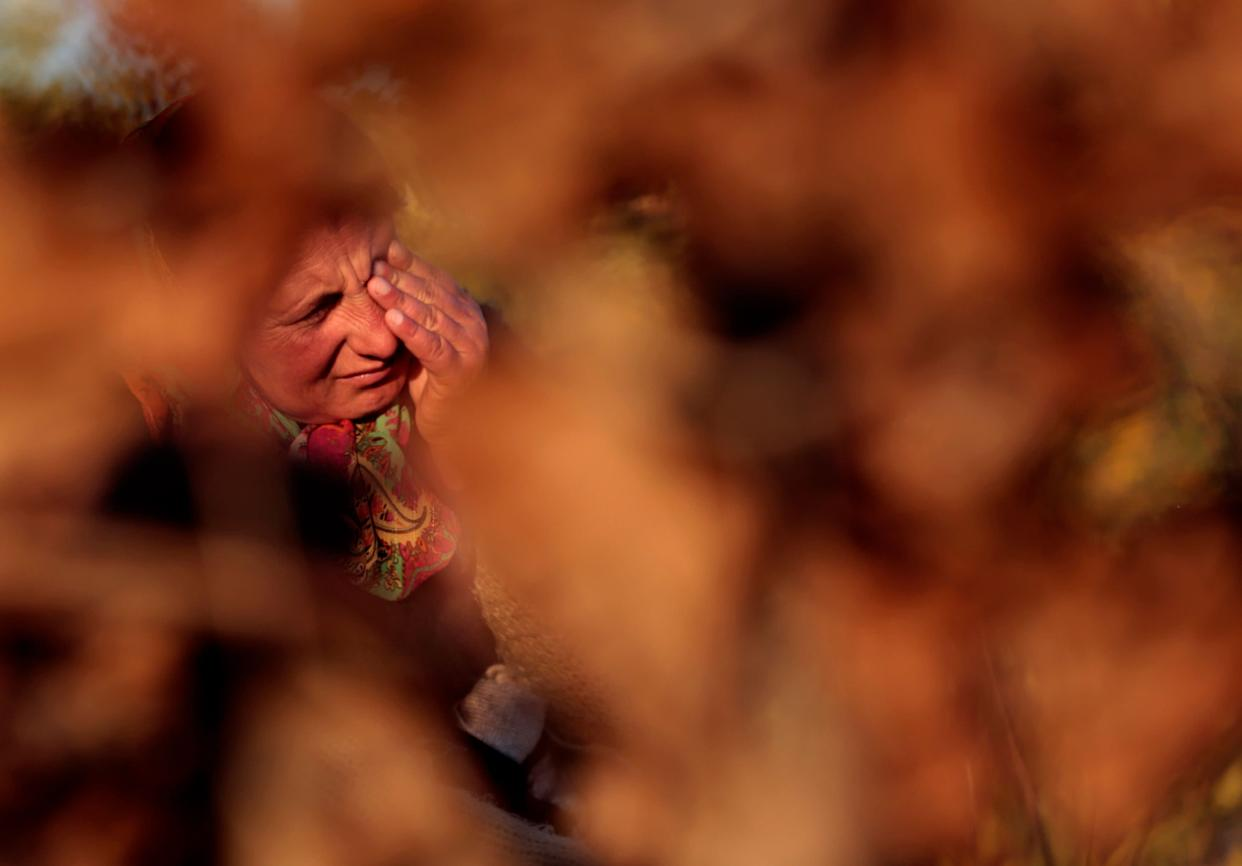 A Roma woman cries after the announcement of their eviction from an illegal camp on the bank of the Var river in Nice, southeastern France, November 21, 2013.